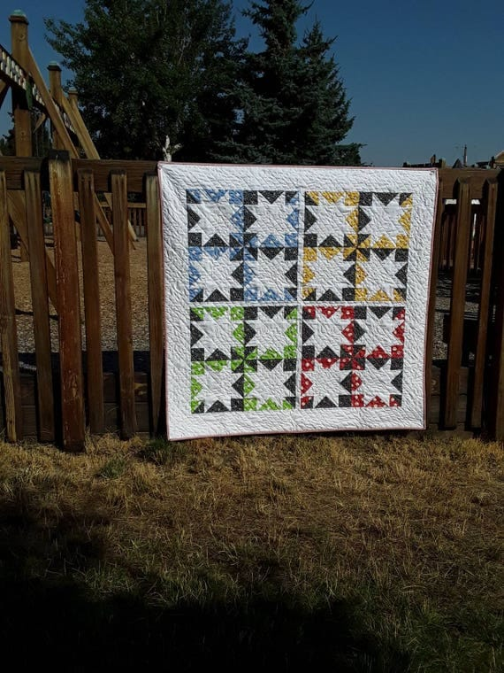 Modern Quilt Kit. Star Pattern Design Using Washington Street Studio Feedsack Fabric And Pattern From Suzy Quilts For Arts and Craft Sewing