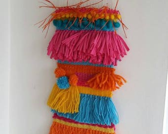 Funky wall weave.Bright colours with pom pom and fringe detail.Perfect for a fresh quirky look.Love these vivid colours