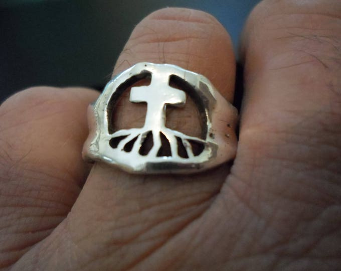 Melted men's rooted in cross ring