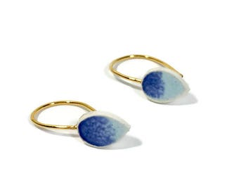 Ceramic Earing with teal glazed drop bead. 100% handmade bead with gold plated 925s sterling dangle.