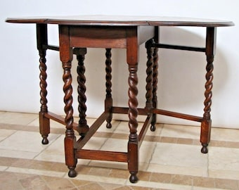 Gorgeous Round Antique Tiger Oak Barley Twist Eight Gate Leg drop leaf Table, Nationwide shipping available please call for best rates