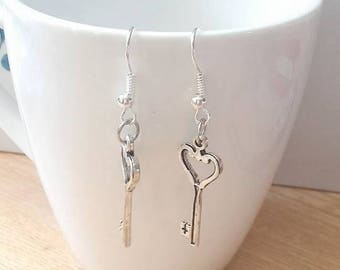 'The key of love' • earring holes collectible •