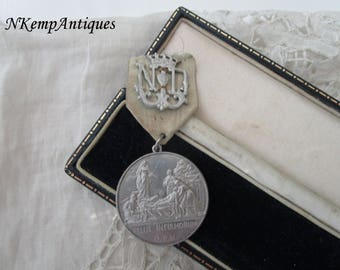 Antique religious medal and ribbon