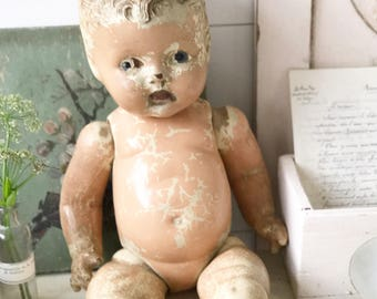 A lovely time worn 1930's doll