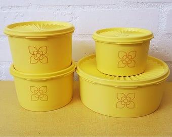 Set of 4 vintage Tupperware storage tubs in yellow