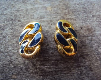 Goldtone blue enamel clip on earrings with chain design