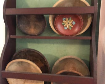 Vintage wooden bowl rack with bowls