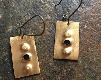 Gold / brass long drop earrings