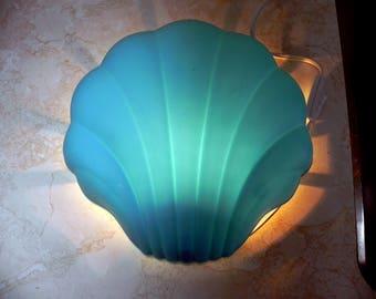 light blue plastic sea shell night light