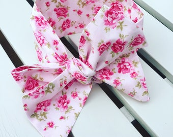 Girl's Headwrap Big Bow Cotton Headband in pink rose floral fabric on a pale pink background