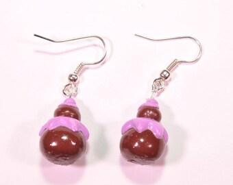 Religious earrings violet