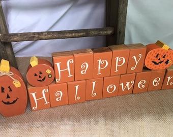 Handmade happy halloween wooden blocks with pumpkins