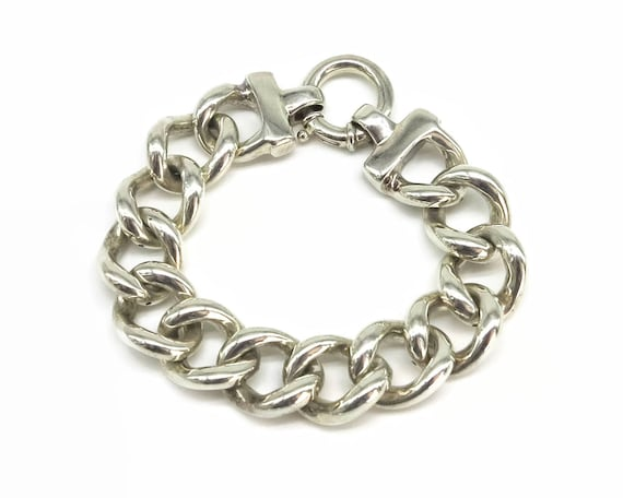 Sterling silver curb link bracelet with large hollow links and large spring back catch, stamped 925, 24 grams