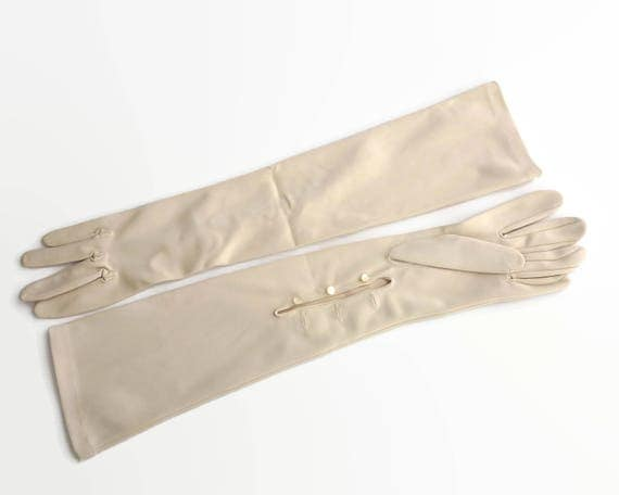 Vintage creamy beige elbow length gloves with plain fronts and 3 pearly buttons on the underside, Dents, size 7, nylon, 1960s