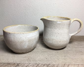 Sugar bowl and creamer in white and yellow
