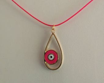Large teardrop pendant with pink evil eye on pink wax cord