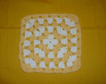 """GRANNY SQUARE TRIVET - Crocheted in Yellow and White, 7.5"""" length, 7.5"""" width."""