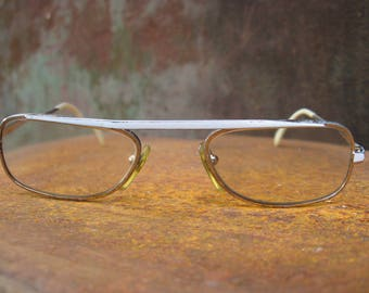 Narrow Futuristic Eyeglasses. 1980s 90s vintage French silver metal glasses with white browline accent, modern design. Pearl ear pieces.