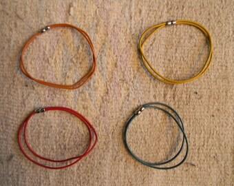 Ball closure leather cord bracelet