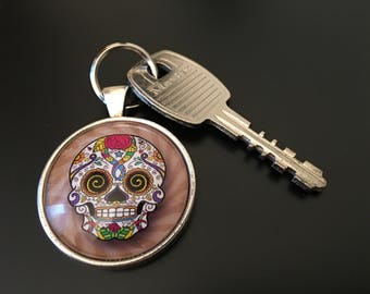 "Key Chain  -  "" Sugar Skull "" image SSR6C6 under glass dome."
