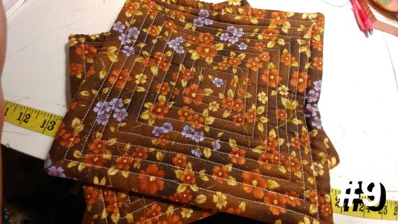 CHARITY (Brown with orange, yellow & purple flowers HOT PAD set of 2 #9)