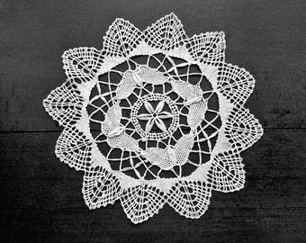 Off white vintage bobbin lace doily