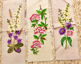 3 floral embroidery on beige background, handmade, mentor, or for craft, sewing...