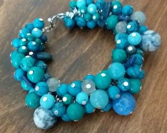 Turquoise and semi precious gemstone cluster statement bracelet