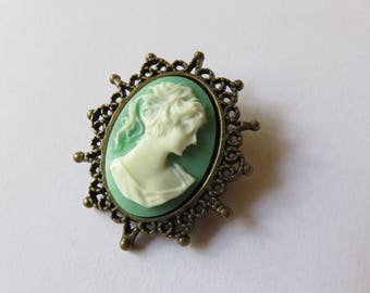 Oval light green & white cameo brooch