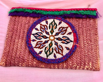 Centerpiece ethnic clutch bag.