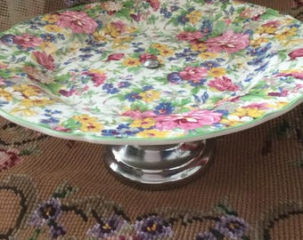 A very pretty Chintz footed cake stand . Plate by Midwinter made in Burselm England