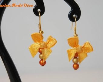 Boucles d'oreille Noeud et perles magiques