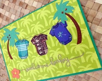 Welcome baby card with Hawaiian onesies on coconut tree clothesline v. 2