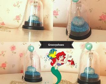 Little mermaid dingle hopper necklace.