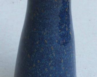 Glossy blue speckled vase