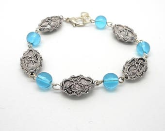 Bracelet beads worked silver, blue glass beads