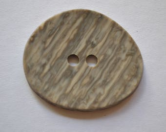large button fancy oval