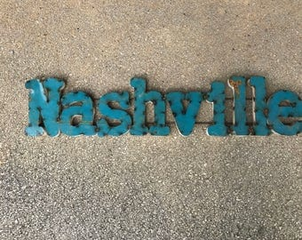 Turquoise painted metal Nashville sign