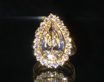 5.16ct Pear Shaped Champagne Diamond Handmade Ring in 18K Yellow Gold. Total diamonds' weight: 6.21ct.