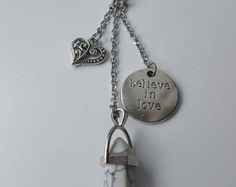 "Keychain in stone white howlite with heart charms and ""believe in love""."