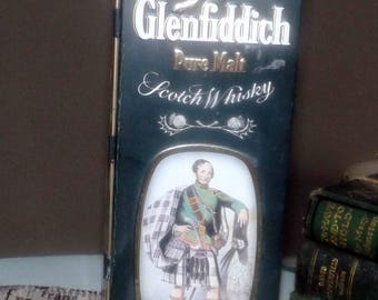 Vintage (c.1980s) Glenfiddich Clans of the Highlands Clan MacPherson lithographed (empty) single-malt scotch whisky tin.  Made in England