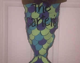 Magical mermaid tail burlap back door hanger.  Brighten up your curb or room!