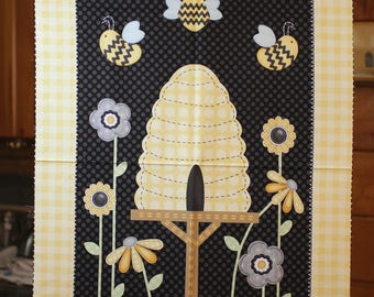 Sew Bee It:  a bee and hive fabric panel.