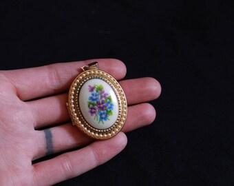 vintage porcelain violets pearl trimmed gold locket •large floral locket pendant necklace • blue & purple violets, faux seed pearls •AVON