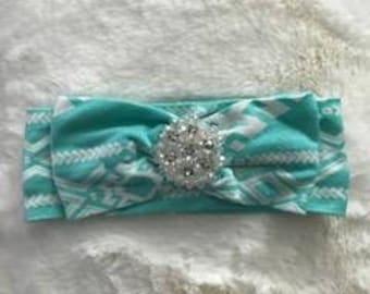 Turquoise aztec knit with matching bow