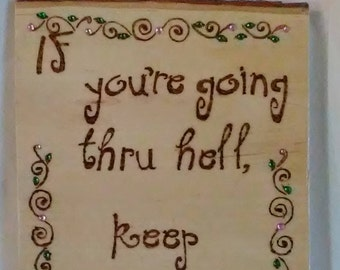 Wood burned painted and embellished plaque with inspirational saying If you're going thru hell...with vines leaves and colored crystals