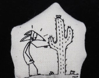 PIN screen printed with Tweed blundering Fox being pricked her finger with a cactus