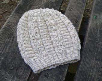 Warm winter hat for women in off-white, hand knitted beanie with textured pattern, snugly fitting but very stretchy and elastic, warm beanie