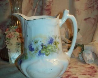A pretty Creamer or antique Limoges porcelain milk jug