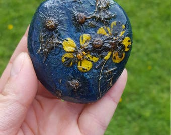 Painted stone with real flowers, flower composition on a beach pebble, paperweight, acrylic painting with real plants, decorative stone
